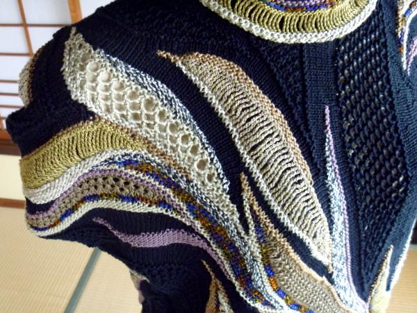 Вязание спицами шапки с ушанками 83