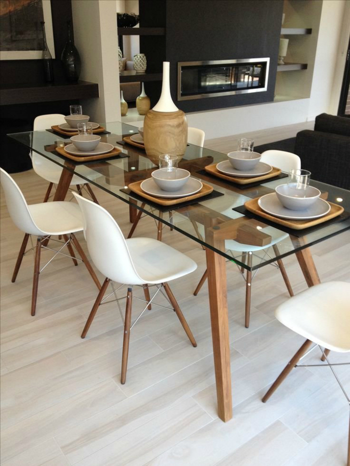 post_lovely-glass-dinning-table-1-sticotti-glass-dining-table-and-eames-dining-chairs-in-walnut-736-x-981.jpg